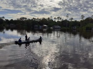 river-boat-village-amazon forest