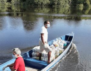 covid-amazon forest-river-boat-men