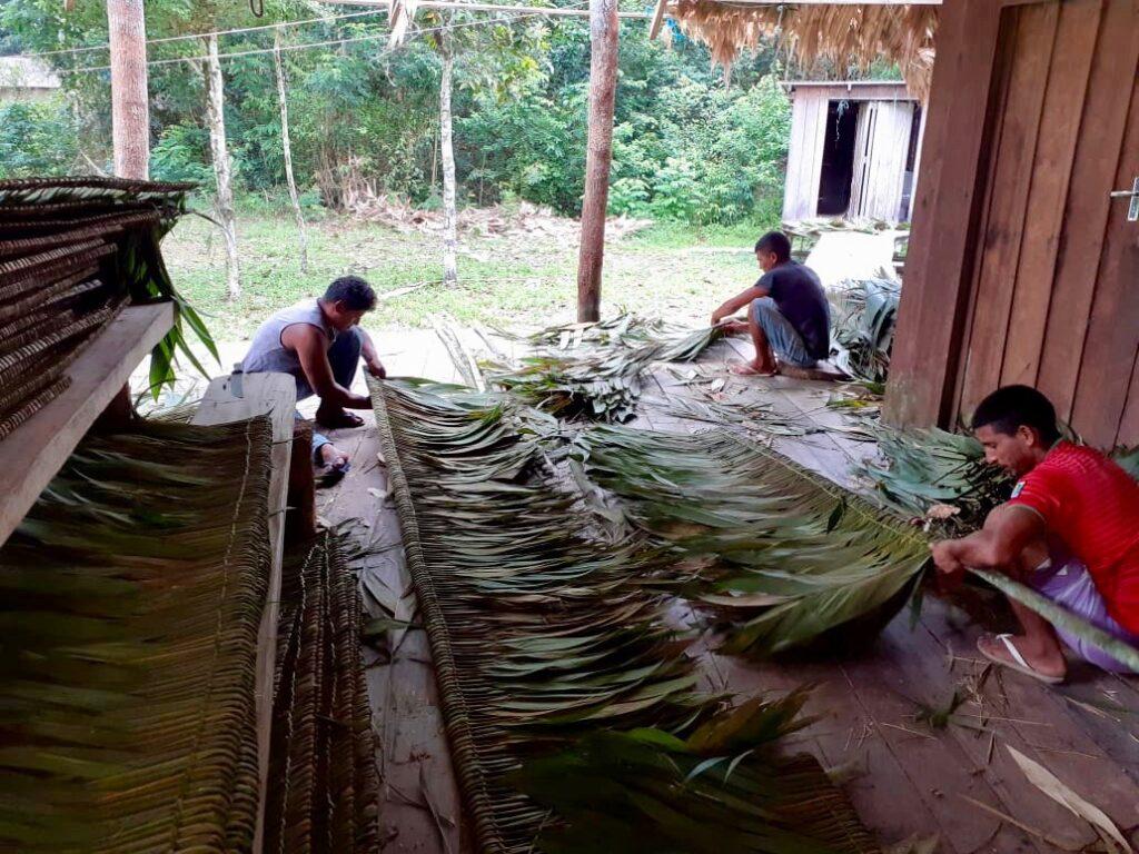 weaving straw on wooden strips